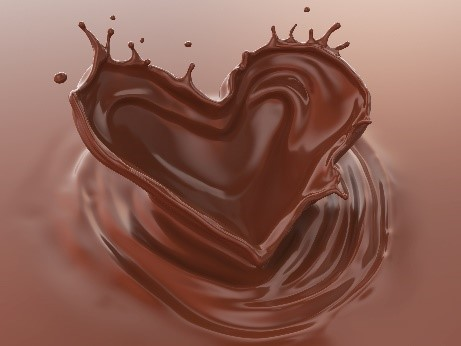 Liquid chocolate forming a heart shape.