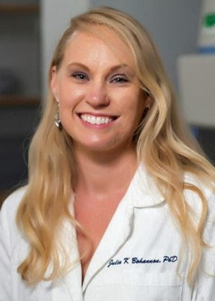 A headshot of Dr. Julia Bohannon wearing a lab coat.